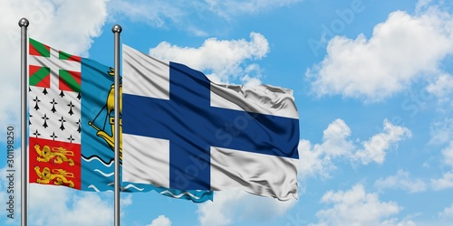Saint Pierre And Miquelon and Finland flag waving in the wind against white cloudy blue sky together Tableau sur Toile