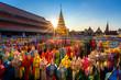 Leinwanddruck Bild - The light of the Beautiful Lanna lamp lantern are northern thai style lanterns in Loi Krathong or Yi Peng Festival at Wat Phra That Hariphunchai is a Buddhist temple in Lamphun, Thailand.
