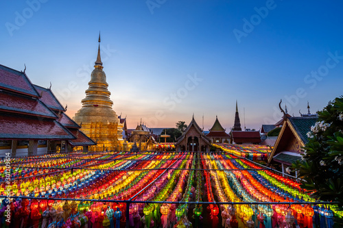 Foto auf Leinwand Altes Gebaude The light of the Beautiful Lanna lamp lantern are northern thai style lanterns in Loi Krathong or Yi Peng Festival at Wat Phra That Hariphunchai is a Buddhist temple in Lamphun, Thailand.