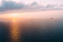 Cargo Ship Sailing Towards Sunset At Horizon, Mallorca, Spain