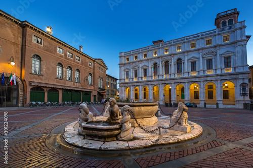 Beautiful architecture of the Piazza Vecchia in Bergamo at dawn, Italy
