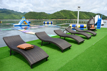 Modern Black Loungers On Artificial Lawn On Poolside