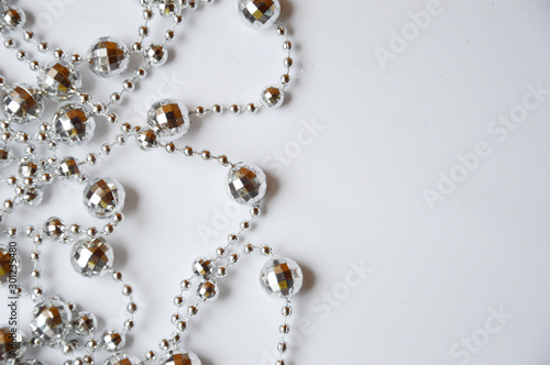 Leinwand Poster  Silver beads for interior decoration on a white background