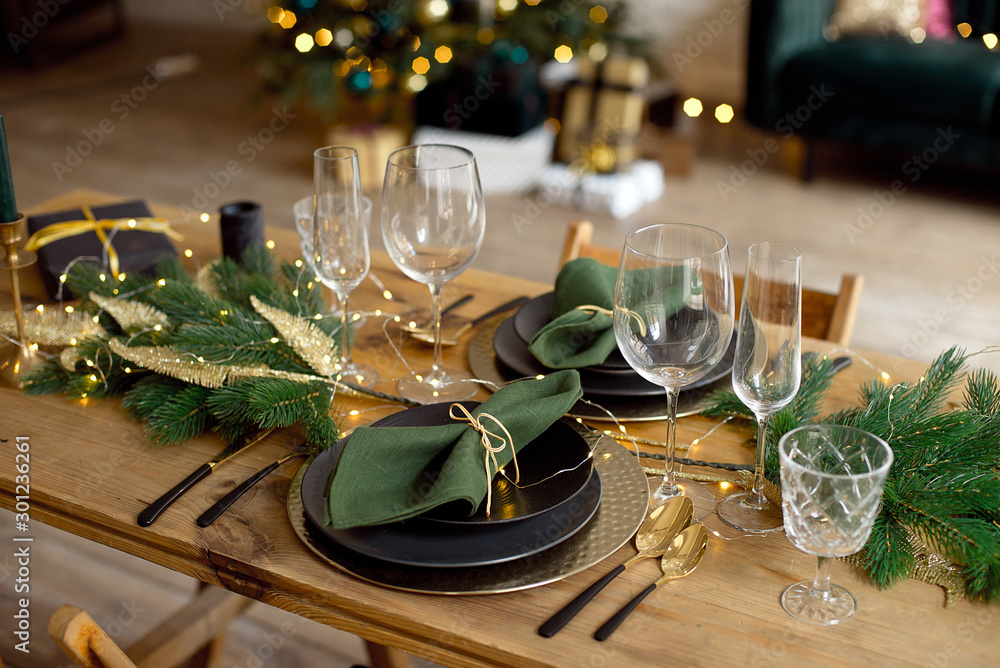 Fototapeta Table served for Christmas dinner in living room, close-up view, table setting, Christmas decoration.