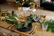 canvas print picture - Table served for Christmas dinner in living room, close-up view, table setting, Christmas decoration.