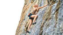 Young Woman Rock Climber Climb...