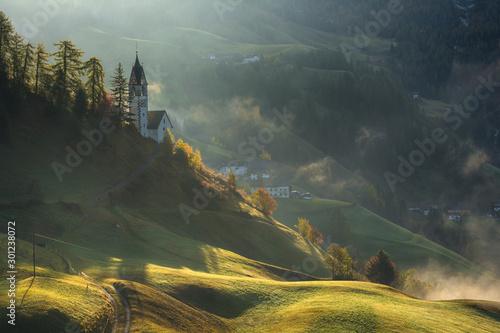 Foto auf Leinwand Khaki Landscape of beautiful village with church in Dolomites mountains