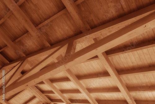 Fotografie, Obraz The construction of a wooden roof made of timber.