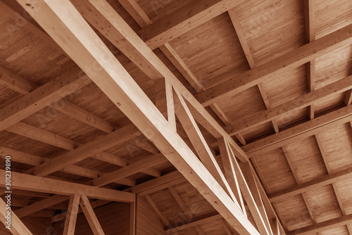 Fototapeta The construction of a wooden roof made of timber. obraz