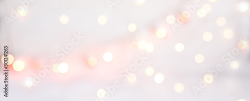 Fototapeta Abstract texture of bokeh christmas lights in rose. Sparkling lights product background. obraz