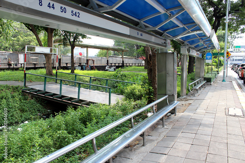 Tuinposter Stadion Bus stop beside the railroad in bangkok thailand