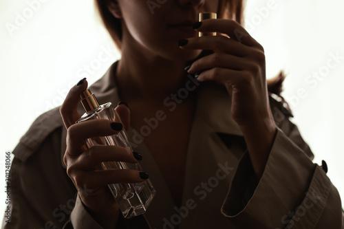 girl smelling perfume Canvas Print
