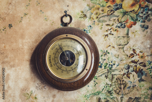 Dusty vintage barometer in old house, the writing is in french Canvas Print