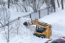 A Small City Excavator Is Used...