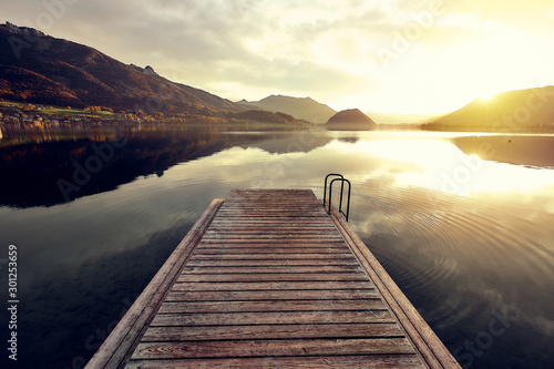 Fotomural  wood planking over the water surface on the mountain lake