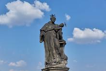 A Bronze Statue Of A Saint Wit...