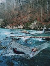 Boy On A Hammock Over A River