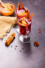 Red Mulled Wine On Burlap. Mulled Wine With Oranges, Cinnamon And Cloves On A Dark Background. Hot Wine With Spices
