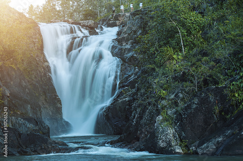 waterfall in Belize and hikers - 301265243