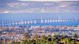 Aerial view of San Mateo Bridge, connecting the Peninsula and East Bay; residential areas of Foster City visible in the foreground ; San Francisco Bay Area, California