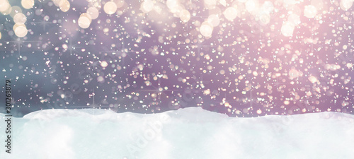 Poster Rose clair / pale snow winter christmas background with snow, snowflakes and bokeh lights blue snowy light bright sky