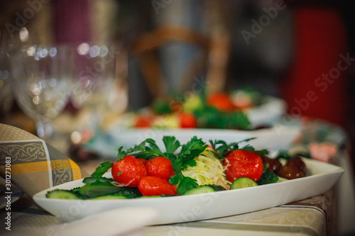Plate with pickles - salty, saline tomatoes, pickles, corned onions and garnished with parsley Canvas Print