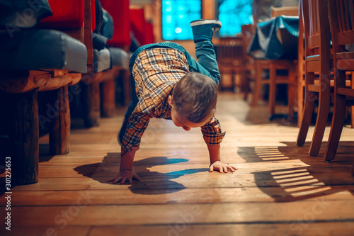 Fototapeta  Cute adorable boy three years old having fun in cafe restaurant