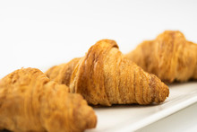 Close-up Of Three Delicious Freshly Made Croissants And Placed On A White Plate On White Background