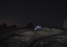 Tent Lit Up Under Starry Night