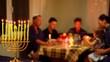 Jewish family eating together festive kosher meals. Hanukkah night. Jewish Holidays and Food. Dinner table