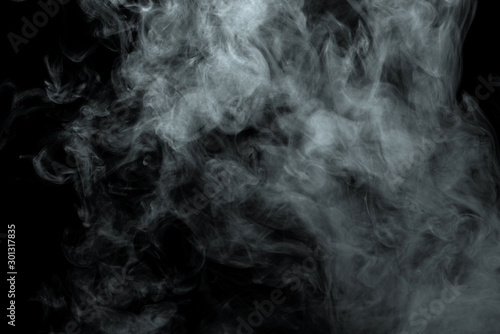 Fotografía  Abstract powder or smoke isolated on black background