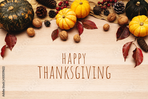 Poster Pays d Europe Happy Thanksgiving Day with pumpkin and nut on wooden background