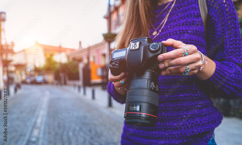 Fototapety, obrazy: Stylish casual traveler photographer woman taking pictures with digital dslr camera and slr lens during walking around european city