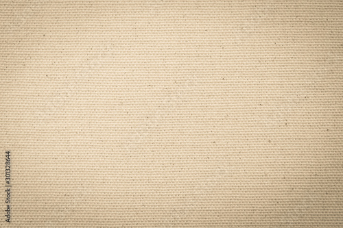 Vászonkép Hessian sackcloth woven texture pattern background in light yellow cream brown