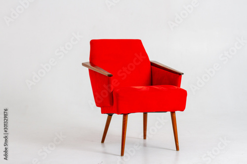 Red armchair on a white background Wallpaper Mural