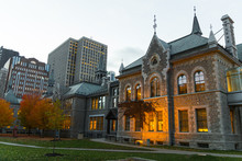 Beautiful Ottawa Stone Building In The Center Of The Capital (Ontario, Canada). Sunset Time, Lights Turned Up Ready For The Night. Low-angle Shot.