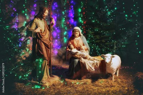 Obraz na plátně Christmas Manger scene with figures including Jesus, Mary, Joseph, sheep and magi
