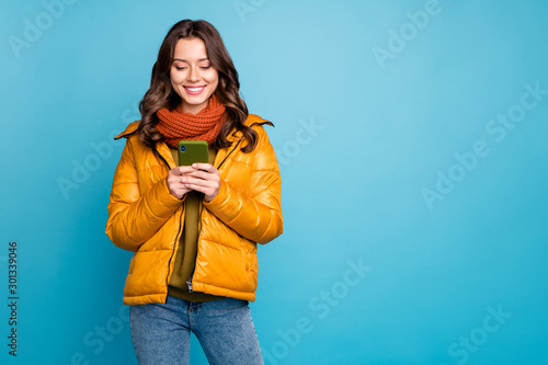 Photo  Photo of pretty millennial lady holding telephone reading positive comments blog