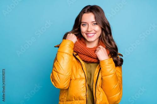 Obraz Closeup photo of amazing millennial lady easy-going person holding knitted scarf wear modern stylish autumn windbreaker isolated blue color background - fototapety do salonu