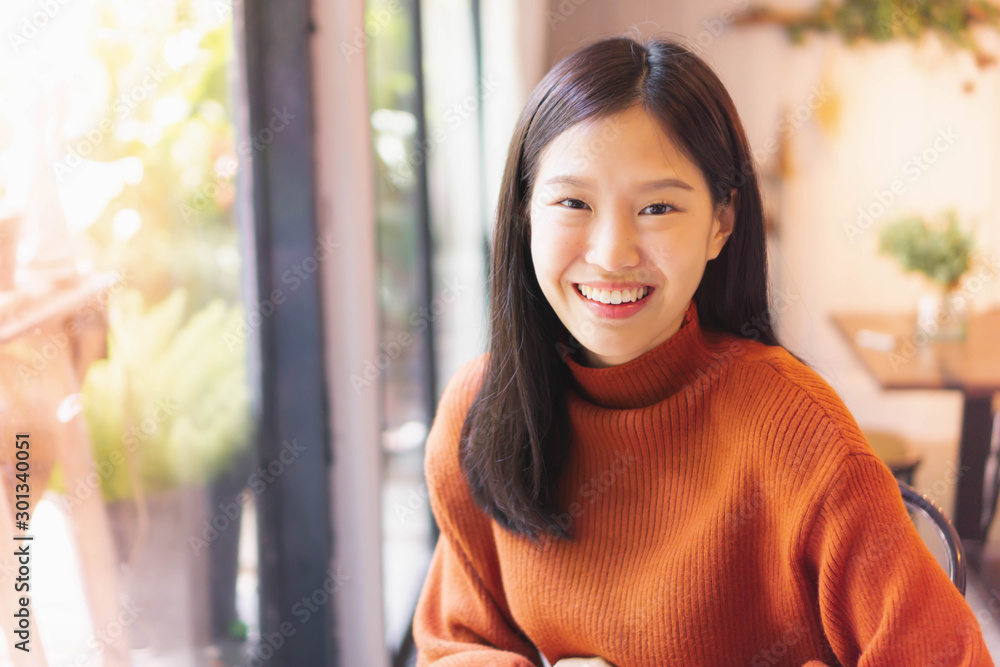 Fototapeta Asian beautiful woman smiling working with laptop  in cafe or restaurant