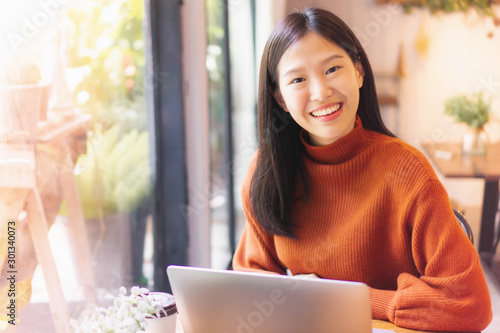 Fototapety, obrazy: Asian beautiful woman smiling working with laptop  in cafe or restaurant