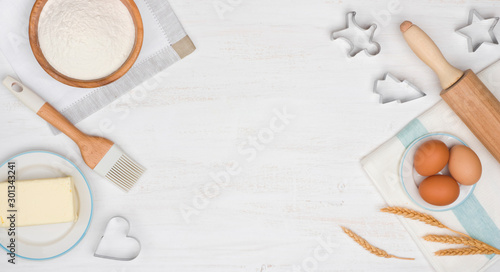 Holiday baking cookies concept with dough ingredients on wooden table Wallpaper Mural