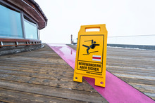 Warning About Slippery Sign In...