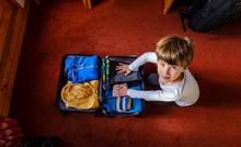 The Child Prepares The Suitcase