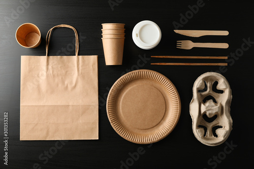 Fotografie, Obraz  Flat lay with eco - friendly tableware on black background, top view