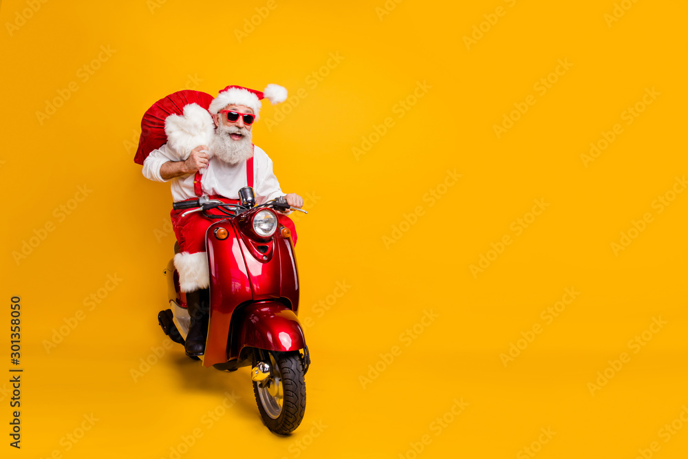 Fototapety, obrazy: Full body photo of crazy funny santa claus in red hat drive hurry fast motor cycle hold sack christmas x-mas preparation ride north-pole wear shirt suspenders isolated yellow color background