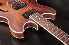 Hollow Body Jazz Guitar On A Dark Background