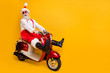 canvas print picture - Full body photo of funny santa white hair grandpa rushing newyear party speed retro bike wear trendy sun specs red trousers cap shirt boots isolated yellow color background