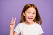 canvas print picture - Close up photo of pretty excited little ginger lady showing v-sign symbol saying hi to school classmates friends wear white t-shirt isolated purple background