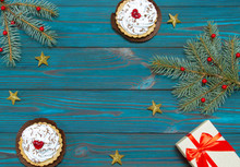 New Year's Composition. Cake And Gift Box With A Red Bow On A Blue Wooden Background. Christmas, Winter, New 2020 Year Concept. Flat Lay. Top View And Copy Space.